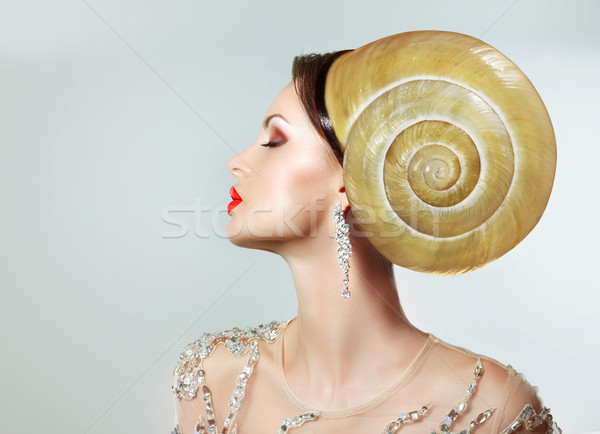 Extravagancy. Outlandish Extreme Hairstyle. Peculiar Woman with Snail as Headwear Stock photo © gromovataya