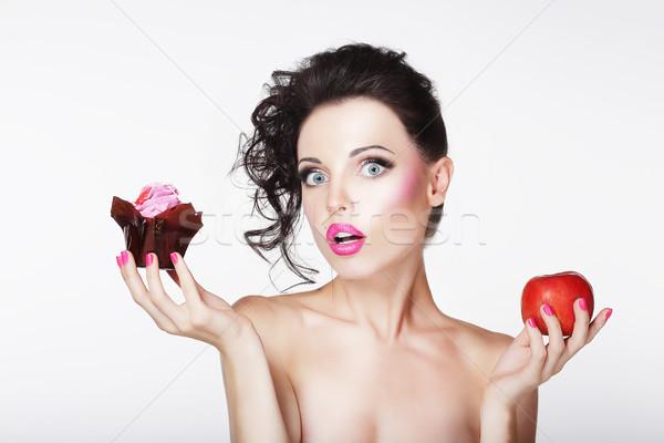 Dieting. Unsure Bewildered Girl Choosing Apple or Cake Stock photo © gromovataya