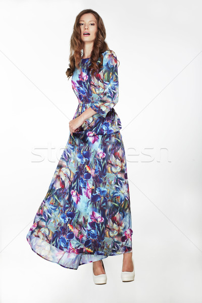 Elegant Fashionable Female in Silky Blue Flowery Dress Stock photo © gromovataya