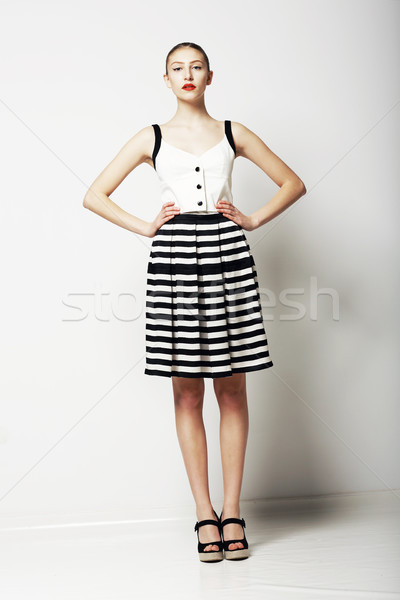 Trendy Woman in Stripped Skirt and T-Shirt standing. Urban Clothing Collection Stock photo © gromovataya