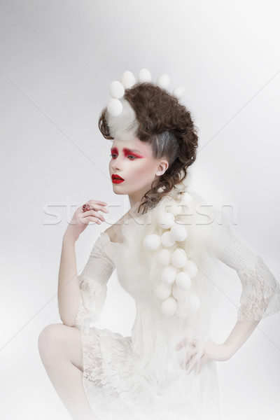 Stylization. Woman with Eggshells and Art Fancy Makeup. Fantasy Stock photo © gromovataya