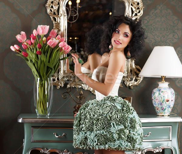 Beautiful Glamorous Woman in Retro Interior with Vase of Flowers. Reflection Stock photo © gromovataya
