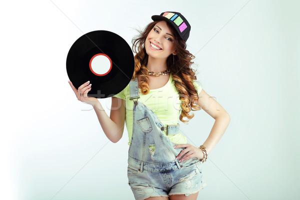 Amusement. Funny Woman holding Vinyl Record and Smiling Stock photo © gromovataya