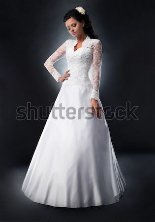 Stock photo: Beautiful bride brunette in wedding white dress on podium