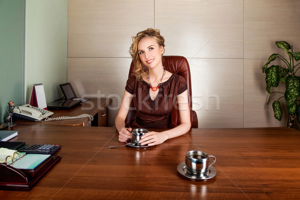 Attractive businesswoman boss siting at office desk - smile Stock photo © gromovataya