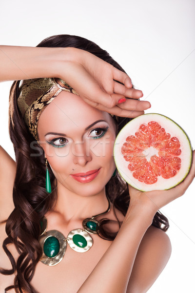 Beautiful Brunette Holding Half of fresh Grapefruit - Preference of Healthy Food Stock photo © gromovataya
