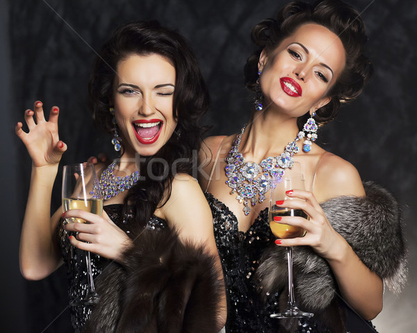 Young women in black elegant dress with champagne - nightlife Stock photo © gromovataya