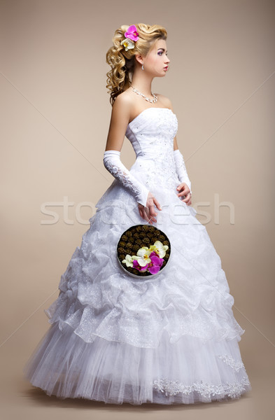 Wedding Style. Bride wearing White Dress and Gloves. Trendy Bouquet of Flowers Stock photo © gromovataya