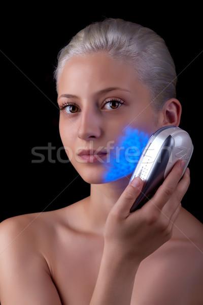 Genç kadın tedavi mavi ışık yüz tıbbi Stok fotoğraf © gsermek