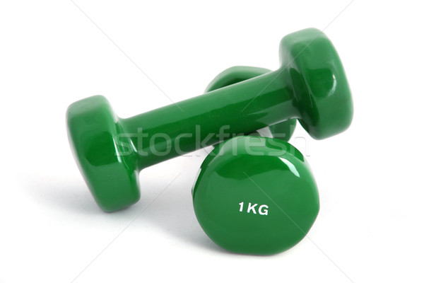 1 kg rubber coated dumbbell on white background  Stock photo © gsermek