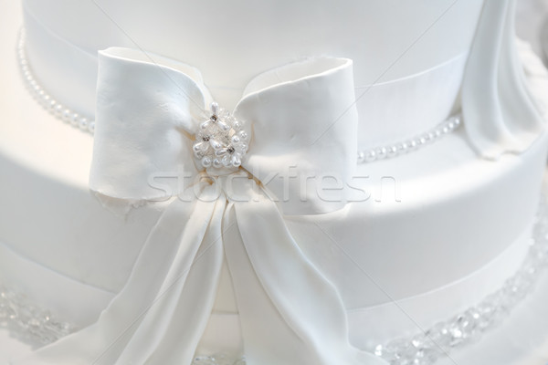 Wedding cake detail - a ribbon with pearls Stock photo © gsermek