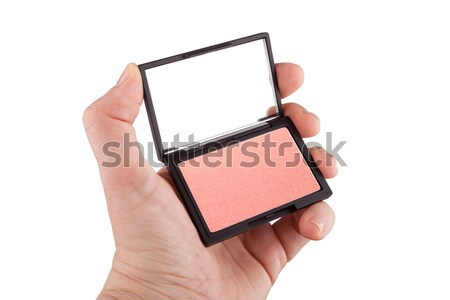 Female hand holding a red blush, isolated on white Stock photo © gsermek
