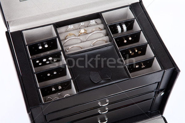 Black leather jewelery box with jewelry inside Stock photo © gsermek