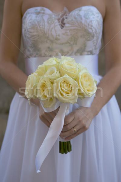 Bride holding white wedding bouquet Stock photo © gsermek