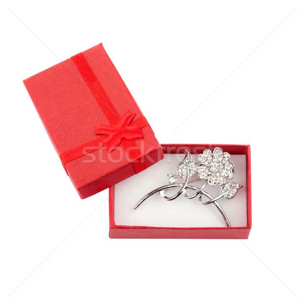Güzel gümüş broş kırmızı hediye kutusu yalıtılmış Stok fotoğraf © gsermek