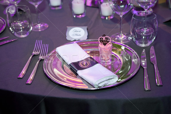 Detail of a wedding dinner setting with purple reflection Stock photo © gsermek