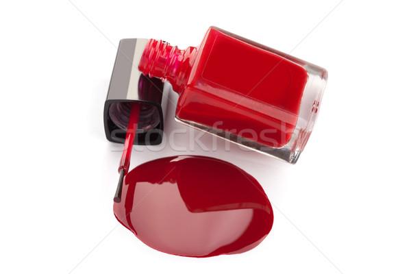 Red nail polish bottle with spilled varnish isolated on white ba Stock photo © gsermek