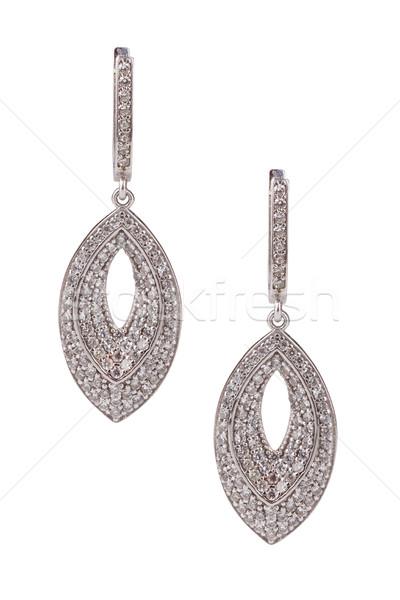 Paar diamant oorbellen geïsoleerd witte Stockfoto © gsermek