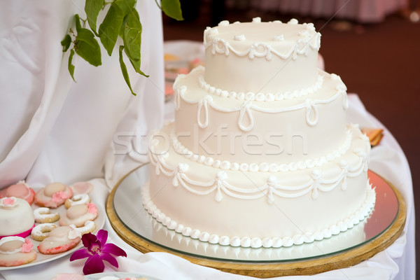 Three tiered wedding cake with white icing  Stock photo © gsermek
