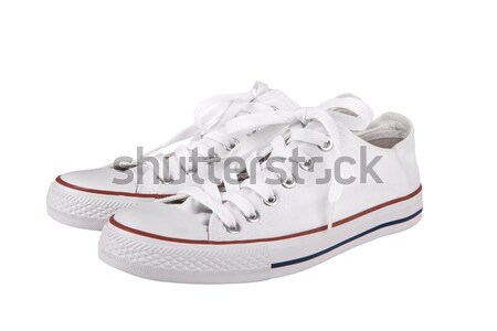 Pair of new white sneakers on white background  Stock photo © gsermek