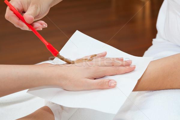 Hand behandeling arts masker Stockfoto © gsermek