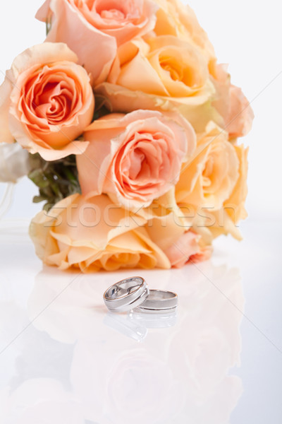 Silver wedding rings and a bridal bouquet Stock photo © gsermek