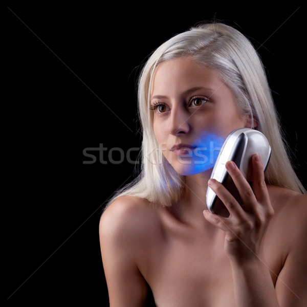 Young woman getting photo-therapy treatment Stock photo © gsermek
