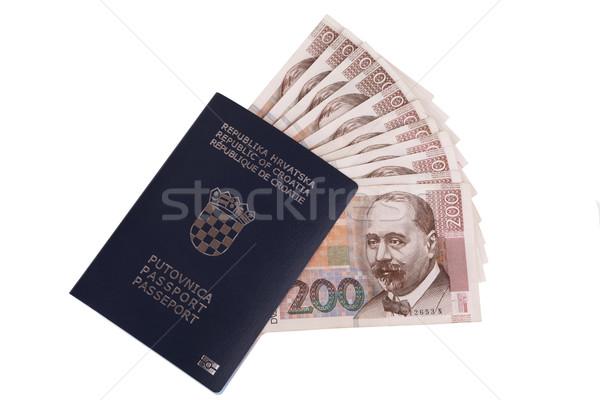 Croatian passport with Croatian money (kuna), isolated on white Stock photo © gsermek