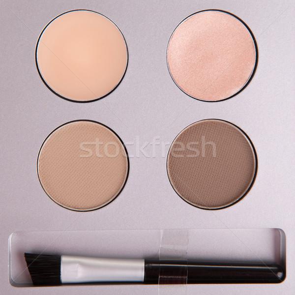 Set of beige eyeshadows and applicator brush Stock photo © gsermek