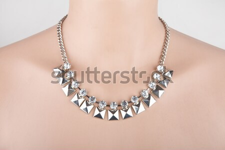 Silver necklace with angel wing and heart on a mannequin Stock photo © gsermek