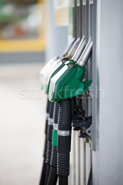 Pump nozzles at the gas station Stock photo © gsermek
