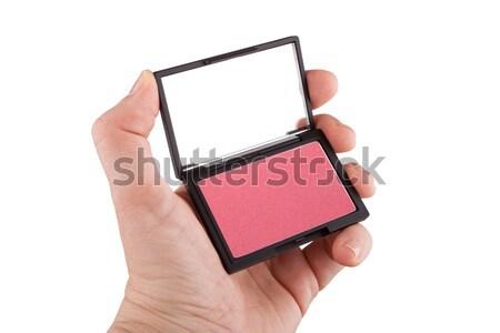Női kéz tart rózsaszín bőrpír izolált Stock fotó © gsermek