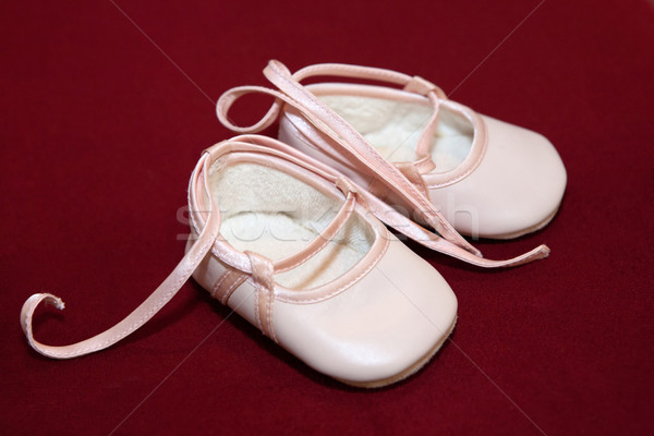 Pink baby shoes on red Stock photo © gsermek