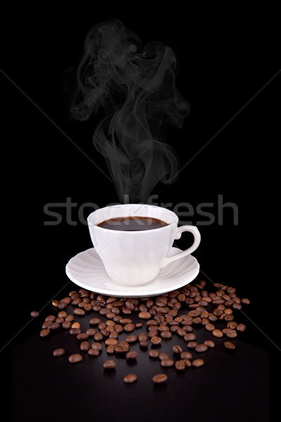 White cup with hot liquid and steam on black  Stock photo © gsermek