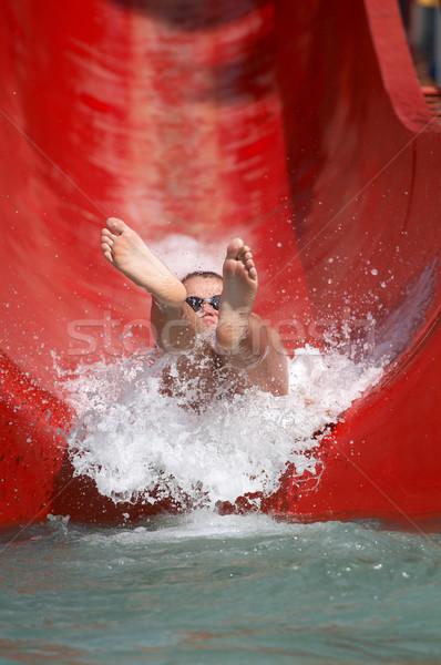 Boy riding down a waterslide Stock photo © gsermek