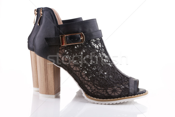 Female shoes with black lace, white sole and a wooden heel, isol Stock photo © gsermek
