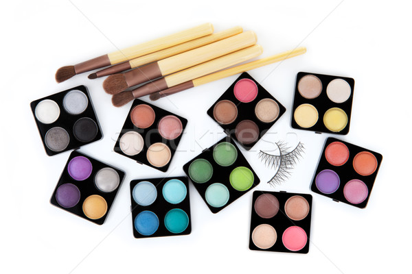 Various eyeshadow palettes, fake eyelashes and cosmetic brushes, Stock photo © gsermek
