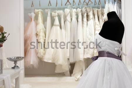 The range of wedding dresses on hangers and on a mannequin in th Stock photo © gsermek