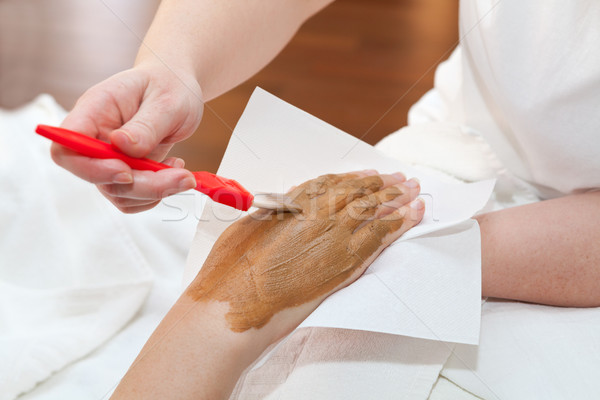 Therapist applying nourishing mask on woman's hand Stock photo © gsermek
