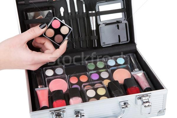 Opened aluminum make up case and female hand holding an eyeshado Stock photo © gsermek