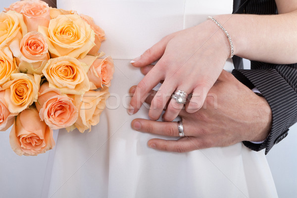 Hands of a newlywed couple Stock photo © gsermek