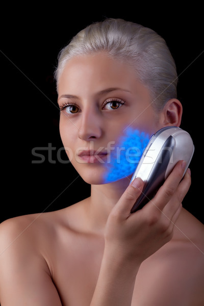 Young woman getting photo-therapy treatment with blue light  Stock photo © gsermek