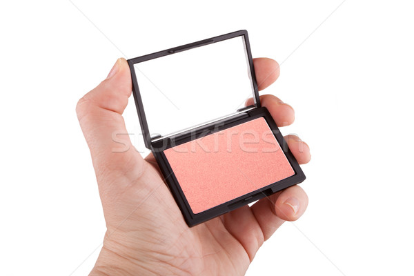 Female hand holding a peach and gold colored blush, isolated on  Stock photo © gsermek