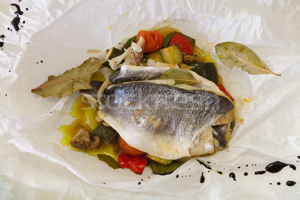 Sea bream in a paper bag Stock photo © gsermek
