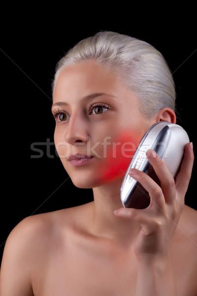 Genç kadın tedavi kırmızı ışık yüz tıbbi güzellik Stok fotoğraf © gsermek