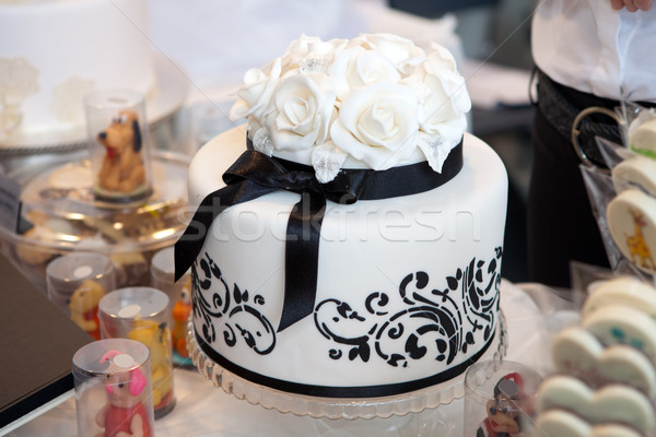 Elegant wedding cake with white roses Stock photo © gsermek