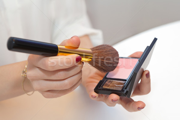 Professional make up brush in hand on pink blush Stock photo © gsermek