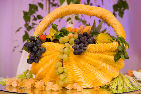 Fruit basket carved from pumpkin and filled with fruit  Stock photo © gsermek