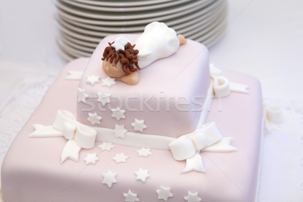 Pink christening cake with little angel on top Stock photo © gsermek