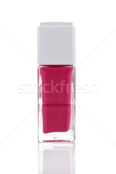Roze nagellak fles reflectie geïsoleerd witte Stockfoto © gsermek